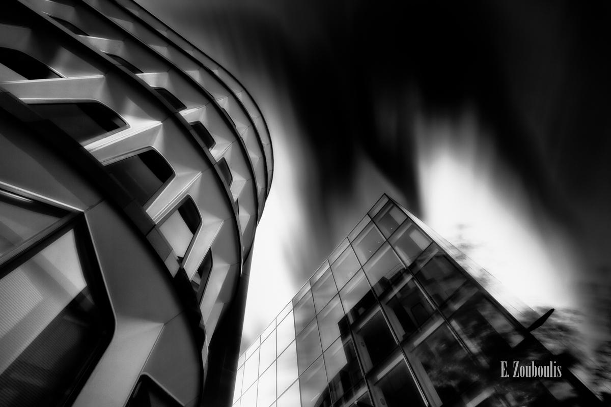 Angel, Angel Investor, Angels Wings, Architecture, Architektur, Banking, Black And White, Britain, Business Angel, Clouds, EZ00047, Engel, England, Fassad, Fassade, Fine Art, FineArt, Flügel, Glas, Glass, Great Britain, Investment, Investment Banking, Investor, Langzeitbelichtung, London, Long Exposure, Monochrom, Monochrome, Schwarzweiss, UK, United Kingdom, Wings, Wolken, Zouboulis, zouboulis photography